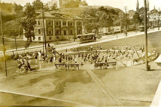 Children playing in a water feature in a Cincinnati park, dated circa 1910s or 1920s